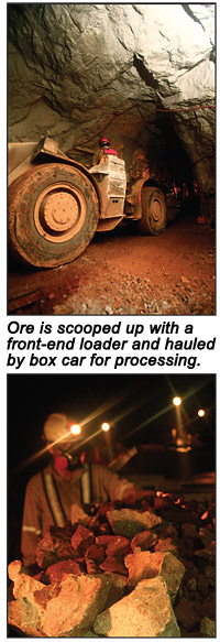 Ore is scooped up with a front-end loader and hauled to the